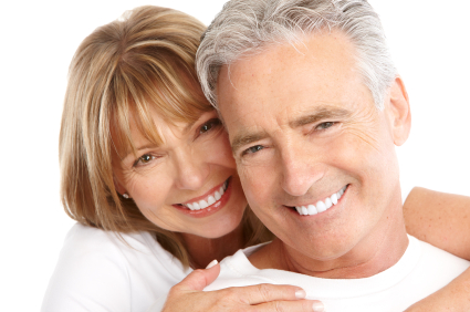 Mature couple smiling about their oral surgeon in San Juan, CA.